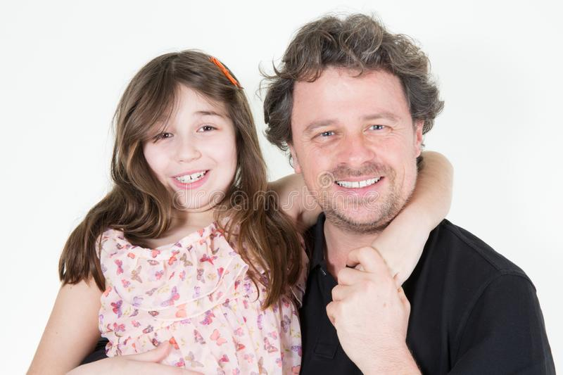Happy father day Child daughter congratulates Daddy and girl smiling and hugging. Family holiday and togetherness stock photo