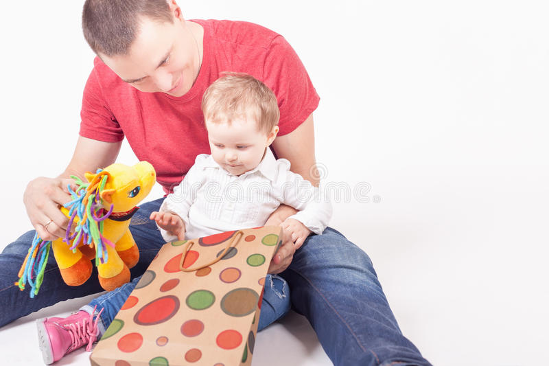 Happy father and funny baby taking purchases royalty free stock photography