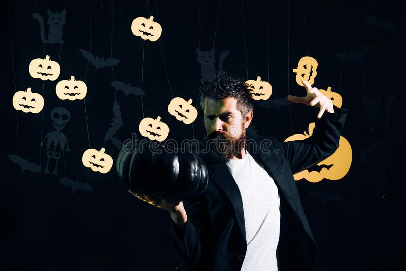 Happy father on halloween background with black magic pumkin. Pumpkin head jack lantern. Halloween party. Surprised. Halloween man stock photos