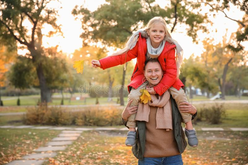Happy father and his little daughter in autumn park stock photos