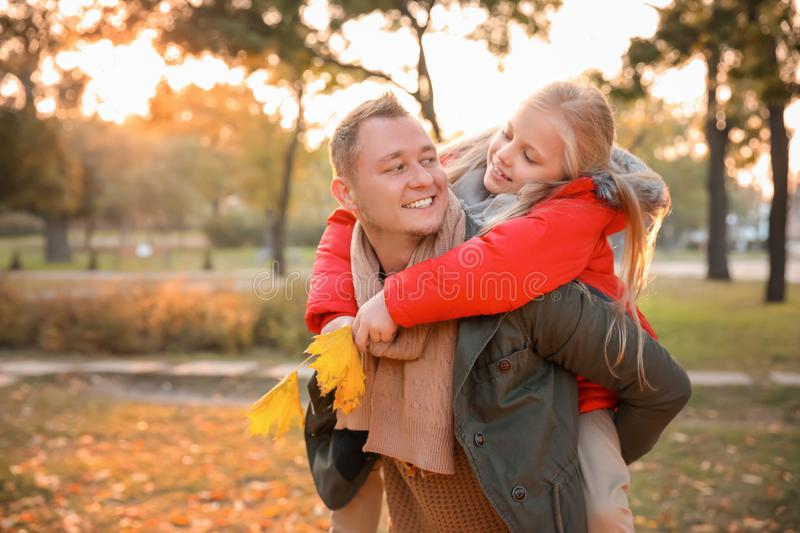 Happy father and his little daughter in autumn park stock photography