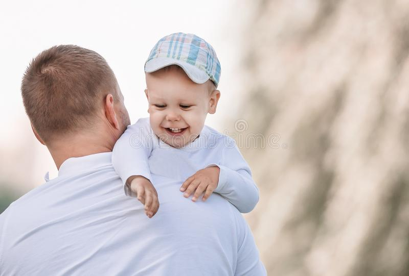 Happy father with his little son standing in a Sunny Park. stock image