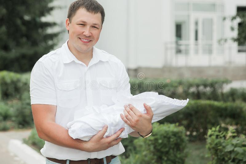 Happy father with his newborn baby standing near the maternity hospital royalty free stock photography