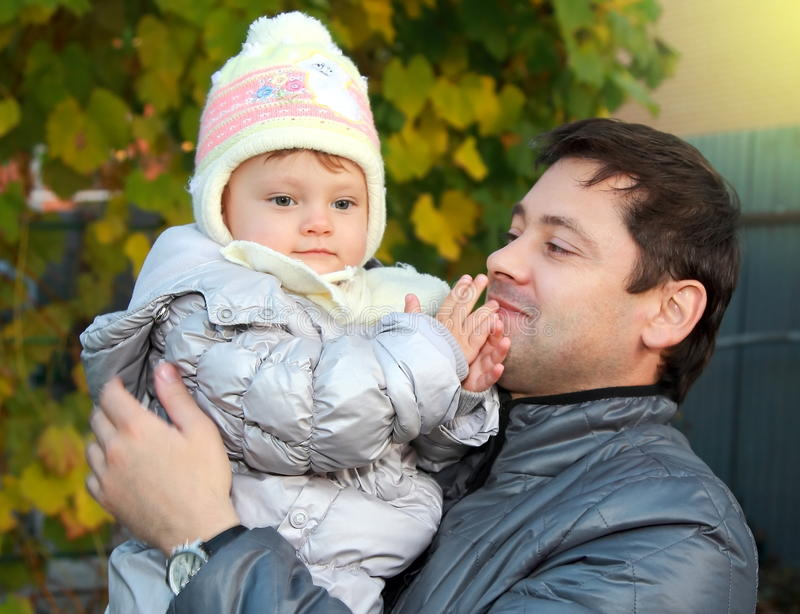 Download Happy Father Holding Baby In Hat Stock Photo - Image: 27266444