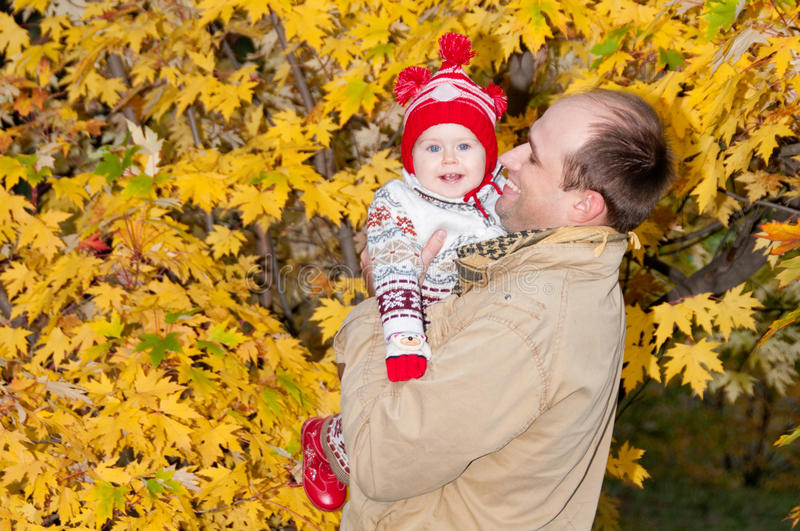 Happy father holds on hands little daughter stock photography