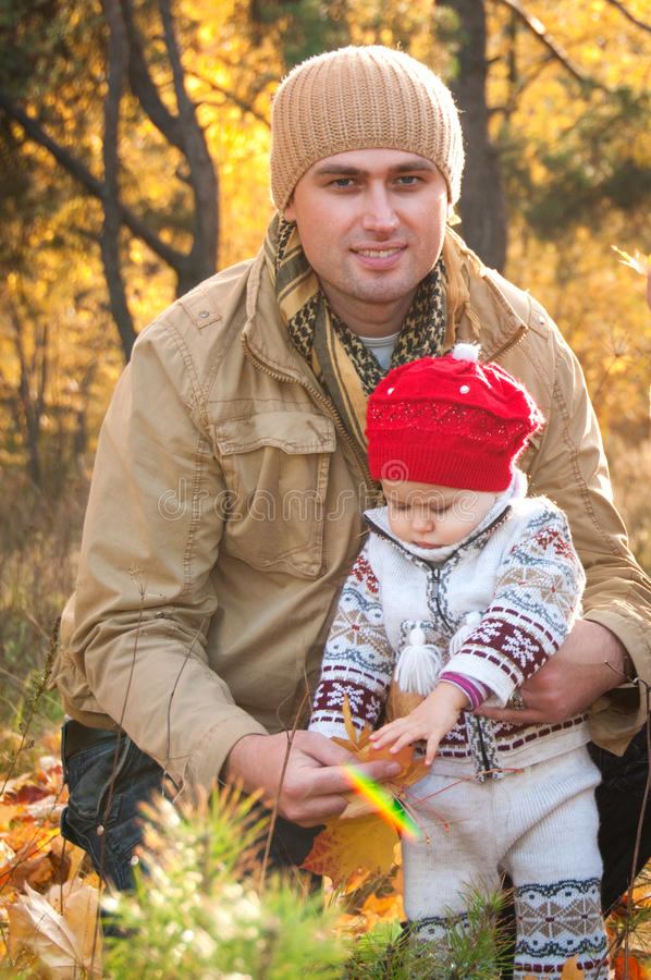 Happy father holds his little daughter. stock photography