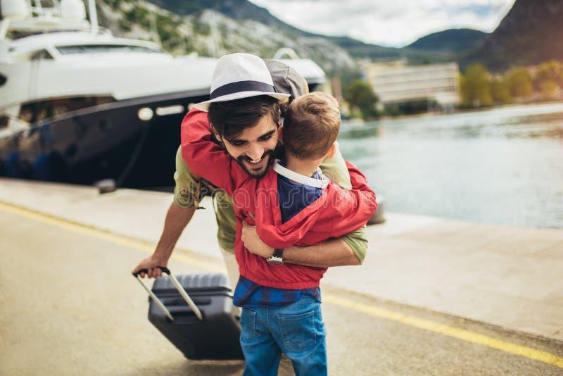 Father hugging little son arriving returning after long trip. Happy father hugging little son arriving returning after long trip stock photos