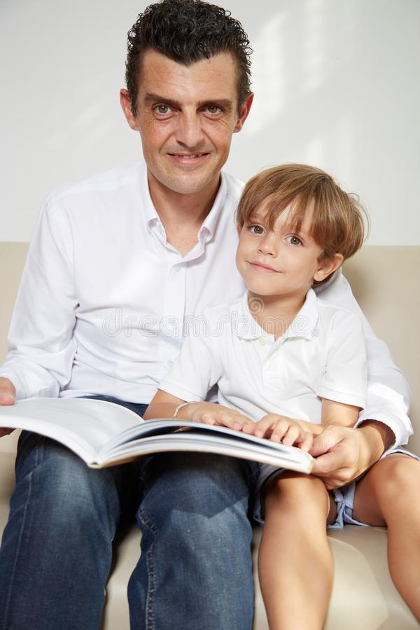 Reading with father stock photo