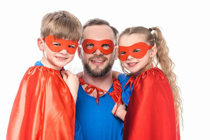 happy father and kids in superhero costumes smiling at camera stock photos