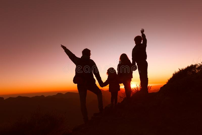 Happy father with kids travel in sunset mountains royalty free stock images