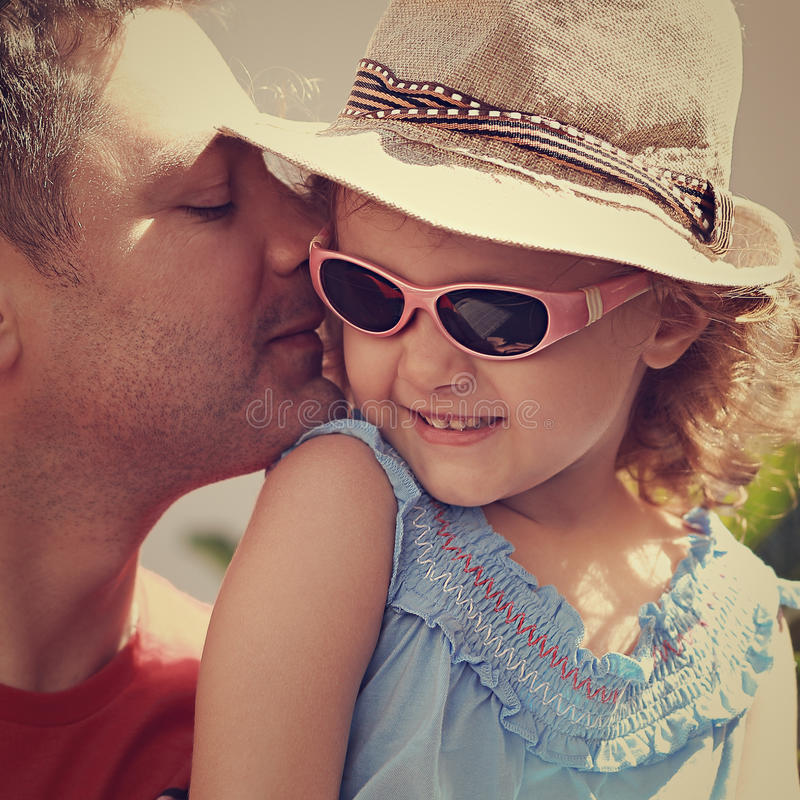 Happy father kissing his daughter in fashion royalty free stock images