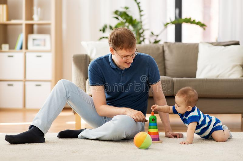 Happy father with little baby son playing at home royalty free stock photos