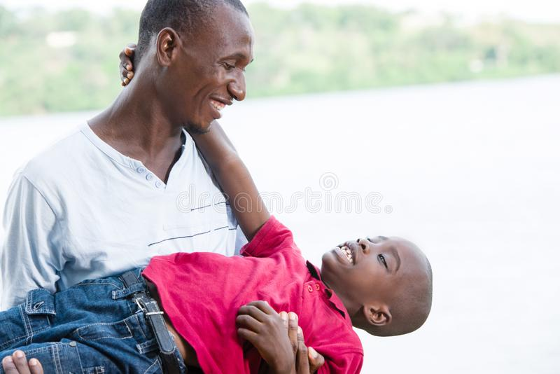 Happy father and little son playing and having fun outdoors royalty free stock images