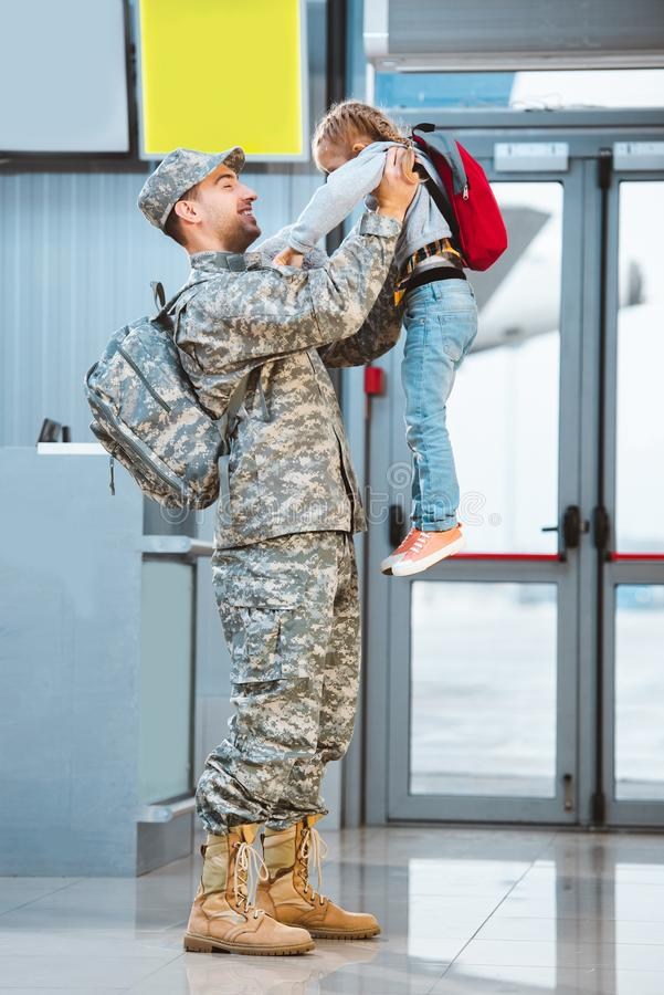 Happy father in military uniform holding in arms cute daughter royalty free stock images