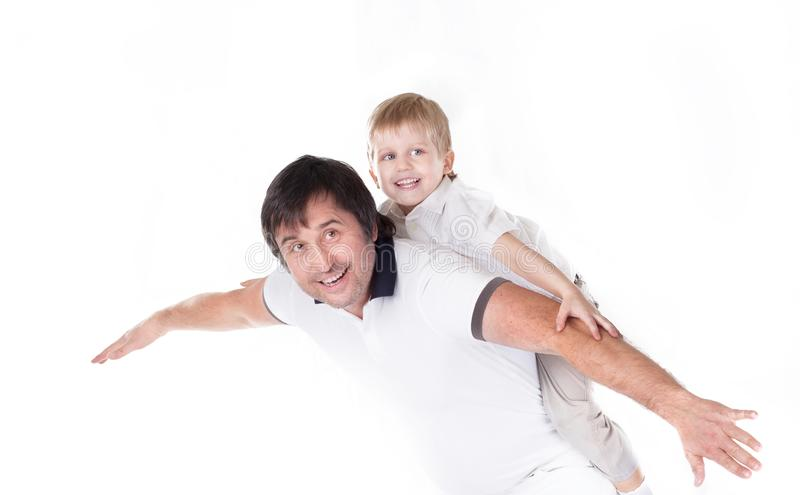 Happy father playing with his little son.isolated on white stock photo