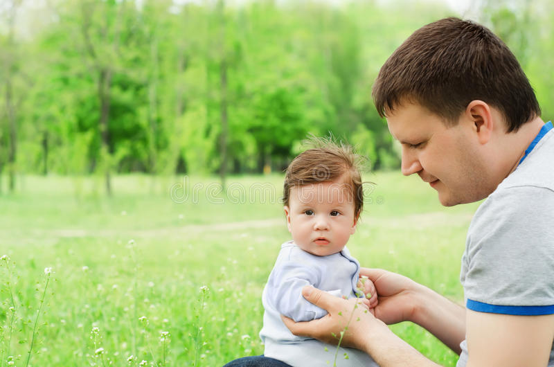 Happy father playing with his son stock photos
