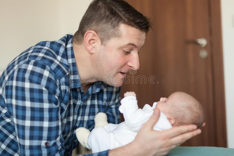 Happy father playing with little baby at home. Family, fatherhood concept. Happy father playing with baby at home. Family, fatherhood concept royalty free stock photo