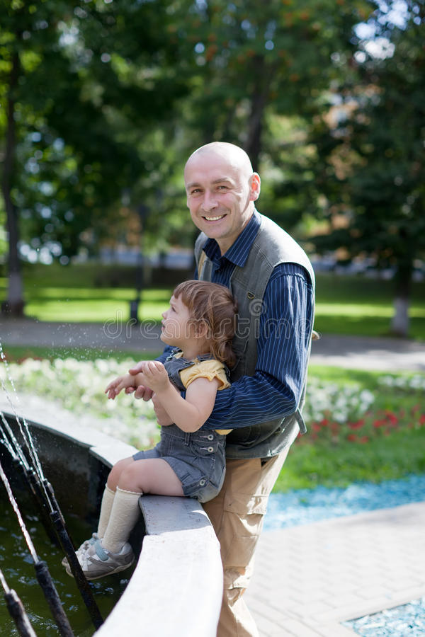 Happy father plays with 2 years baby stock image