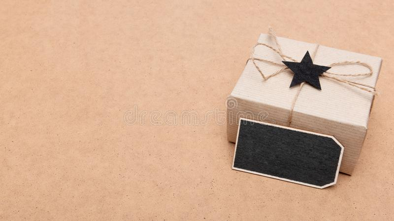 Happy Father`s Day Background. Beautiful retro style gift box and black bow tie on brown background. stock photos