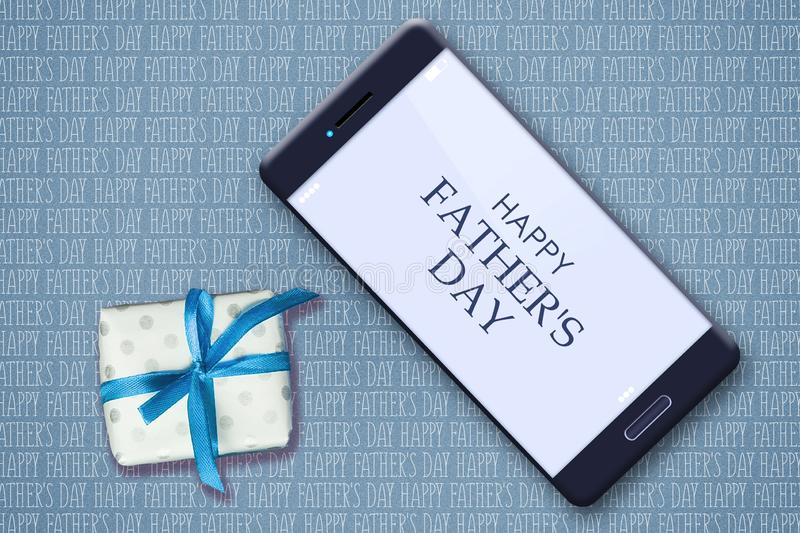 Happy father`s day background. Smartphone and gift on the background of many inscriptions Happy Father`s Day. Congratulatory stock image