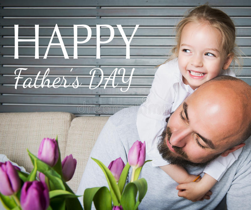 Happy father`s day concept, father and daughter having fun and smiling. Happy father`s day concept, father and daughter sitting on a couch having fun and smiling stock image