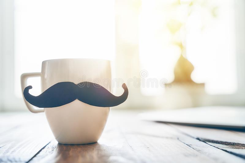 Happy father`s day. ! Cup of coffee on background of wooden table royalty free stock photo