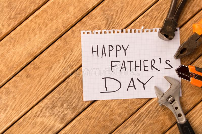 Happy father`s day . Different tools on wooden background.