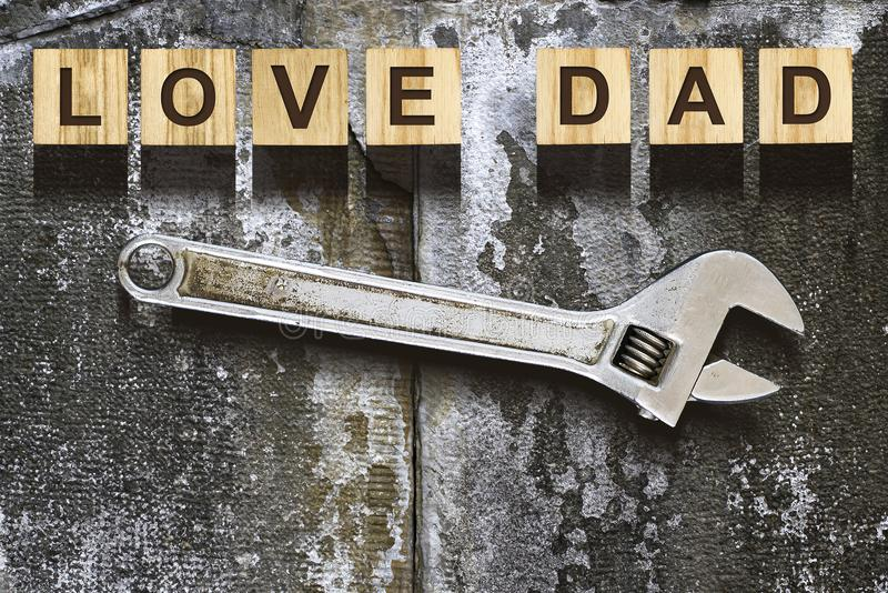 Love Dad inscription on wooden cubes on white background, isolated. Happy Father`s Day Concept. Greetings and royalty free stock images