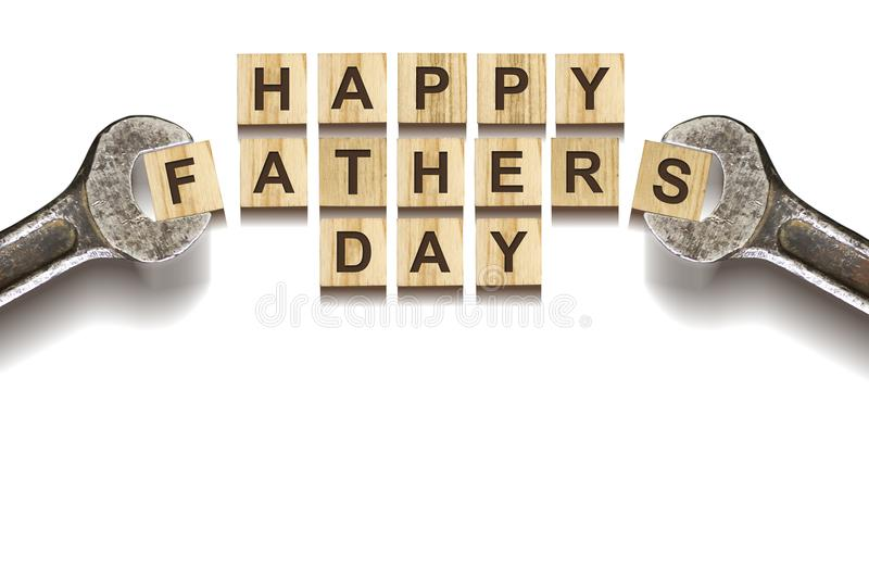 Happy Father`s Day inscription on wooden cubes with working tools on white background, isolated. Happy Father`s Day Concept. Gre royalty free stock photos