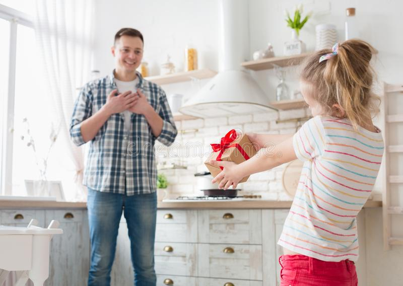 Happy father`s day. Little daughter congratulating dad royalty free stock images