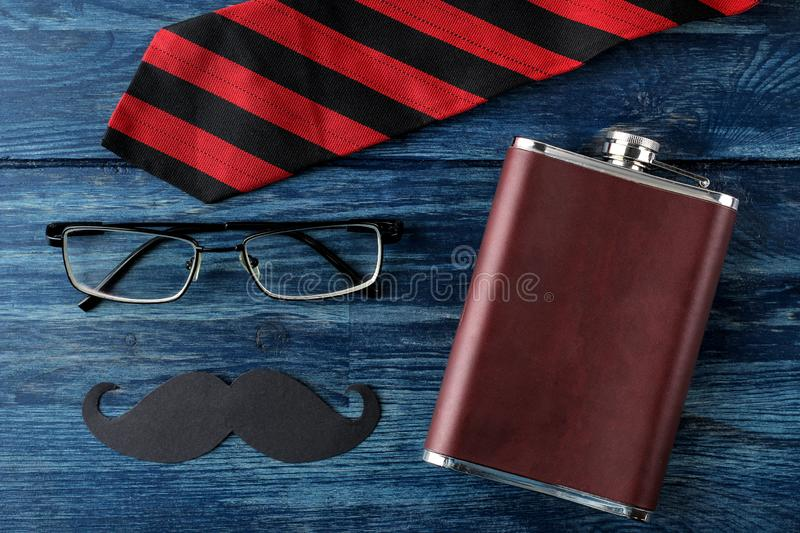 Happy father`s day. men`s tie, glasses and men`s accessories on a blue wooden table. men`s holiday. top view royalty free stock photos