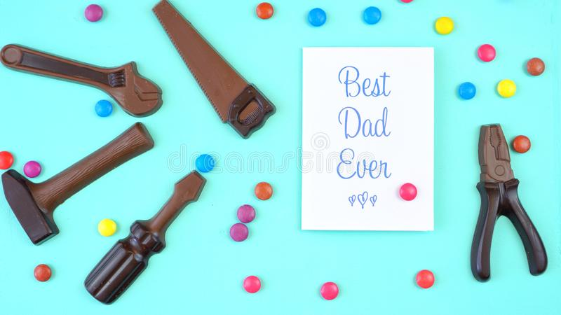 Father`s Day overhead of chocolate tool set with Best Dad Ever greeting card royalty free stock images