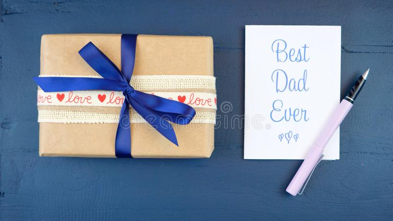 Father`s Day overhead with gift and Best Dad Ever card. stock photos