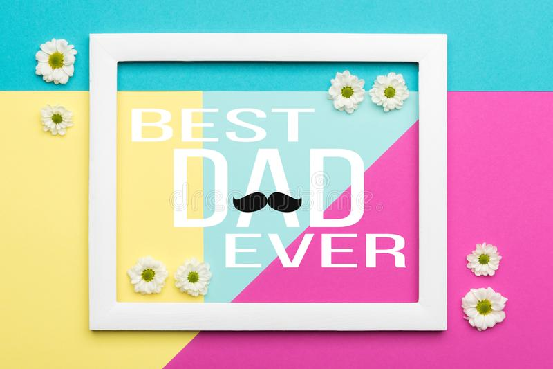 Happy Father`s day Pastel Candy Colours Background. Floral flat lay minimalism geometric patterns Father day greeting card. royalty free stock photography