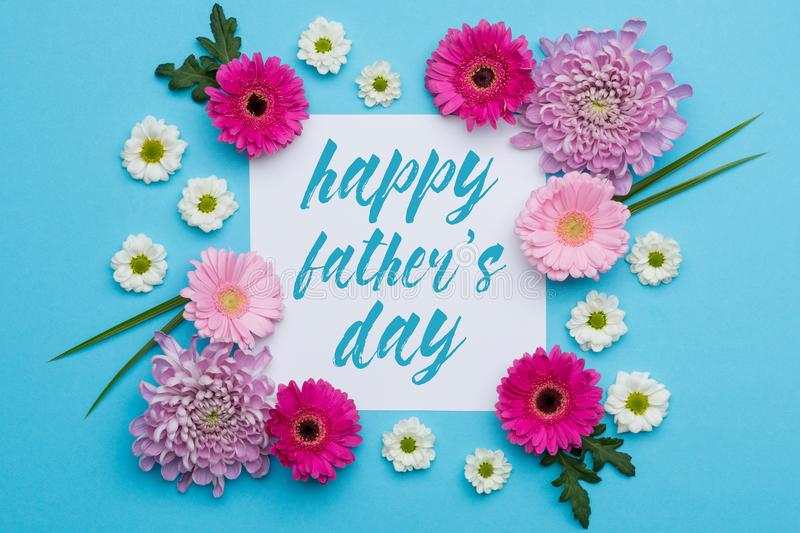 Happy Father`s day Pastel Candy Colours Background. Floral Father day flat lay. stock photo