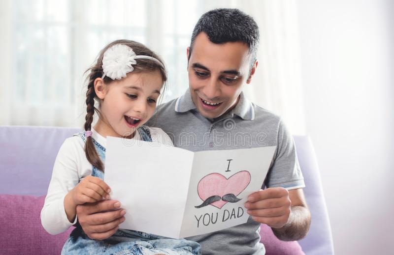 Happy Father`s Day Portrait. Child Daughter and Her Daddy royalty free stock image
