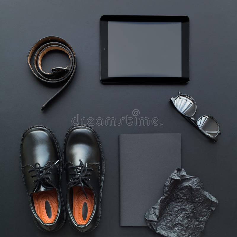 Happy Fathers Day Set with belt, shoes, tablet. Happy Father`s Day Set with belt, shoes, tablet, glasses, notebook as business accessories. Inscription black stock photos