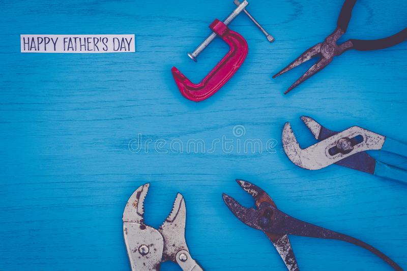 Happy Father`s Day still life concept with worn tools on blue board. Flat lay in vintage setting stock photography