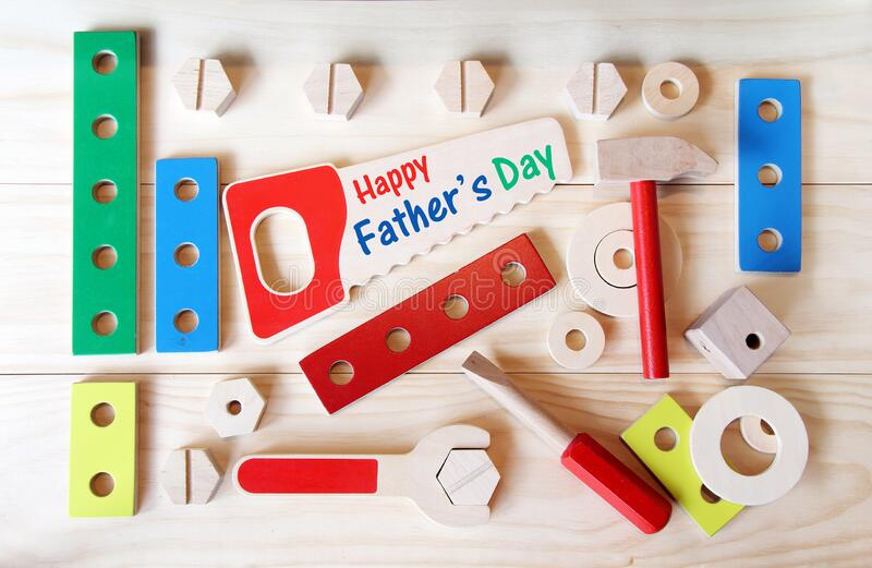 Happy Father`s day tools. Wooden toys, including a hammer, a wrench and a screwdriver. royalty free stock image
