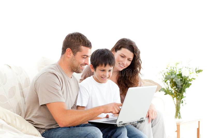 Happy father showing something on the laptop stock image