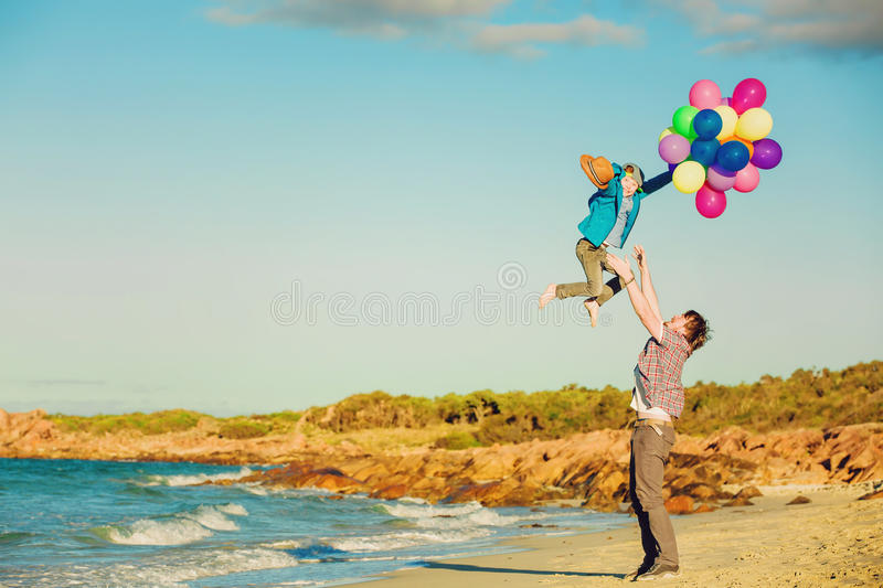 Happy father and son having great time on the stock photos