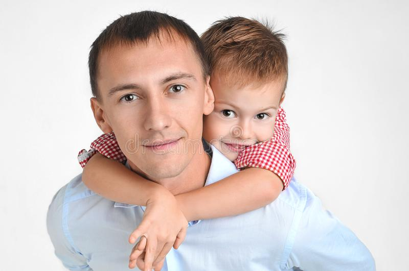 Happy father and son hugging on isolated white background. royalty free stock photo