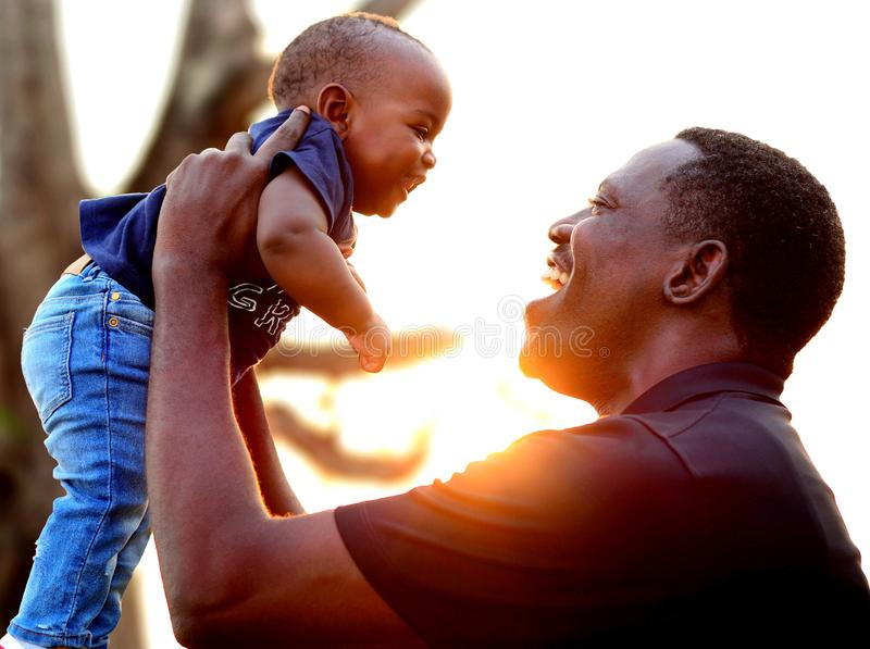 Happy father and son at the park at sunset. Father's day. stock photos