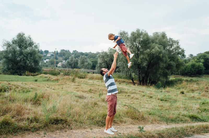Happy father and son playing together royalty free stock photos