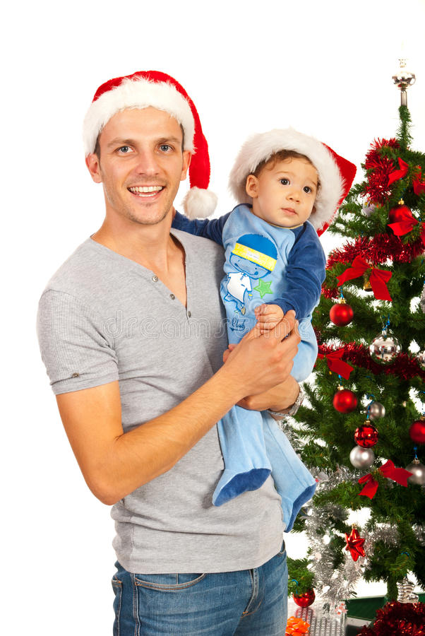 Happy father and son with santa hats. Happy father and son wearing santa hats together stock photos