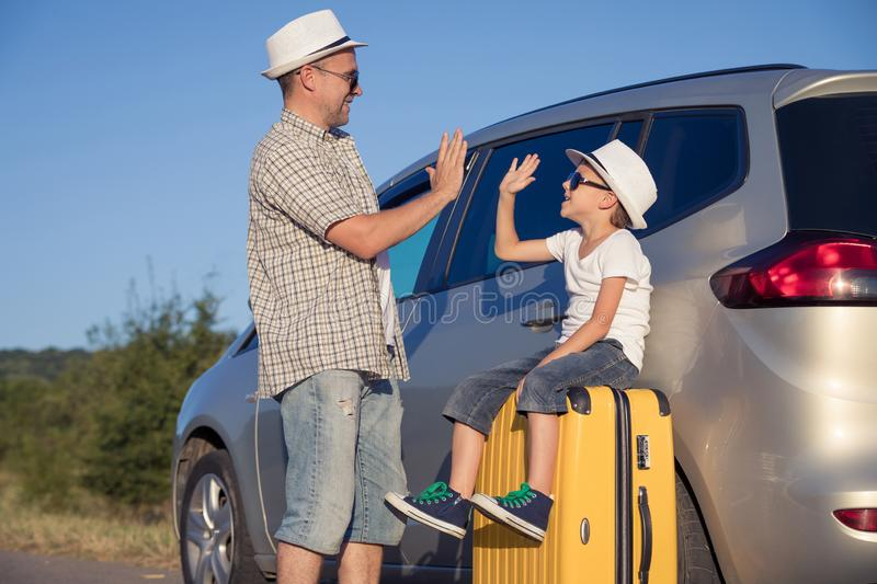 Happy father and son standing near the car at the day time royalty free stock photography