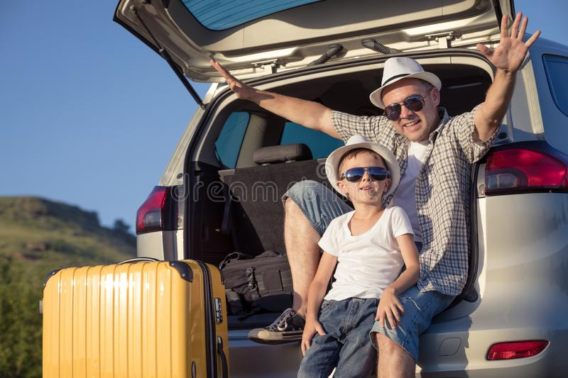 Happy father and son standing near the car at the day time stock photography