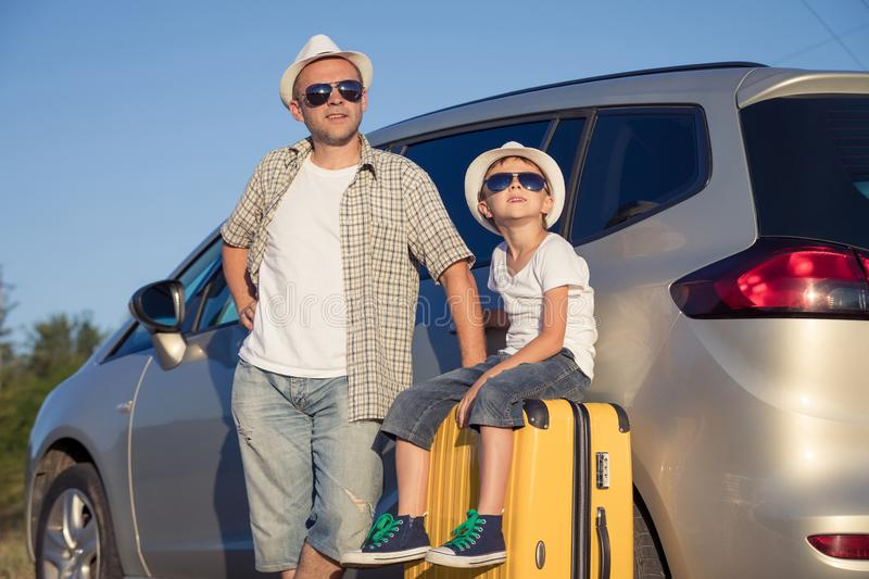 Happy father and son standing near the car at the day time stock photos