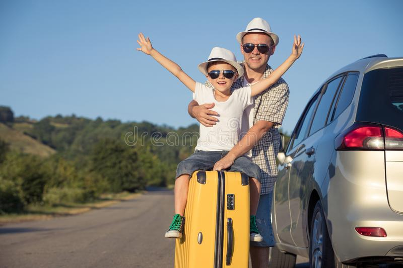 Happy father and son standing near the car at the day time royalty free stock photo