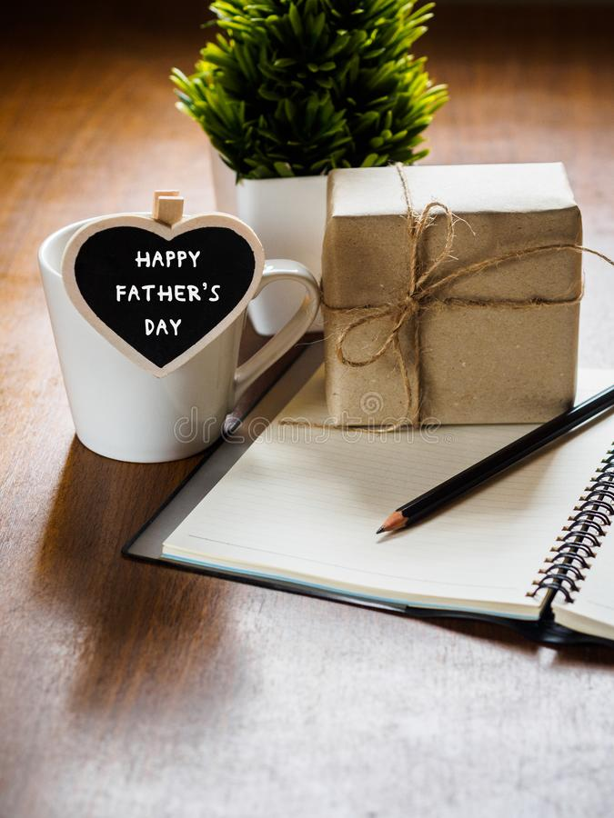 Happy fathers day concept. coffee cup with gift box, heart tag w royalty free stock photography